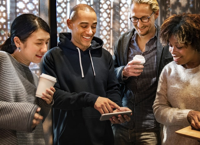 Group of people looking at smart phone